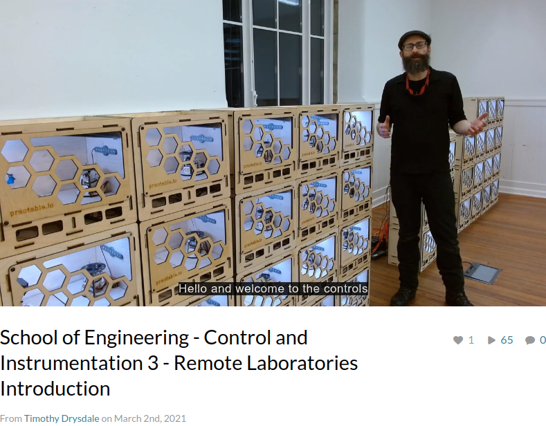 Tim standing with remote labs boxes